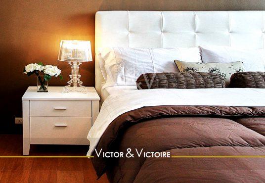Nantes Chézine Appartement chambre confortable appartement bouquet fleur blanche oreiller blanc coussins nature Victor & Victoire agence immobilière Real Estate agency