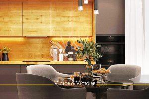 cuisine murale bois et chocolat table ronde breakfast fauteuils Agence immobilière Victor & Victoire Real estate agency