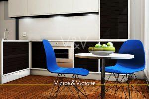 Paris 15e appartement cuisine angle noir blanc table ronde chaises bleu pommes vertes Agence immobilière Victor & Victoire Real estate agency