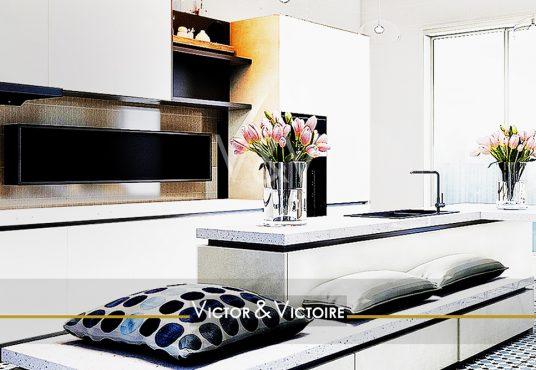 Nantes Chézine Appartement T3 cuisine ilôt central blanc banc coussins grande baie Agence immobilière Victor & Victoire Real estate agency