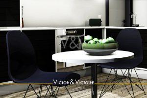 Nantes nord erdre Facultés Appartement T2 cuisine blanc noir table bistrot deux chaises marine coupe pommes vertes Agence immobilière Victor & Victoire Real estate agency