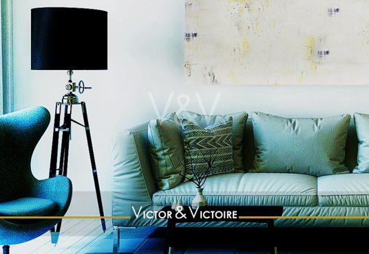 Nantes Universités Erdre Facultés Appartement T2 séjour canapé vert lampe sur pied noir tableau Victor & Victoire immobilier Real estate agency