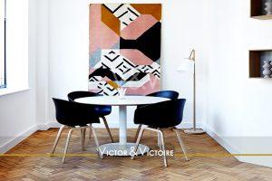 coin repas table ronde quatre chaises tapis mural séjour appartement Victor & Victoire immobilier