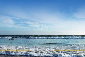 océan ciel bleu vagues écume surfer Agence immobilière Victor & Victoire Real estate agency