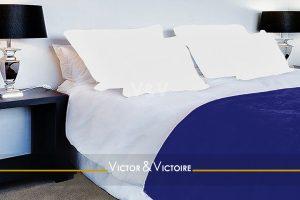 lit chambre blanc bleu bord de mer appartement jardin Sables Olonne Vendée agence-immobilière-victor-victoire-real-estate-agency