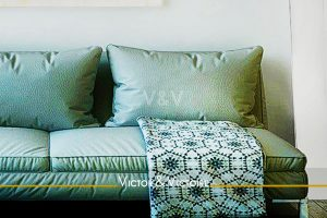 canapé vert appartement maison agence-immobilière-victor-victoire-real-estate-agency
