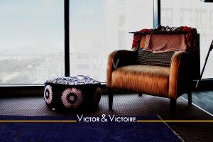canapé face vue imprenable appartement t2 Paris 18e Agence immobilière Victor & Victoire. Real estate agency.